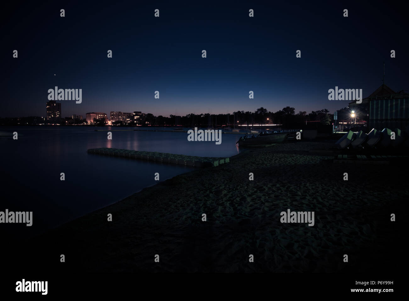 Long exposure of an urban lake on a summer night just after sunset. - Stock Image