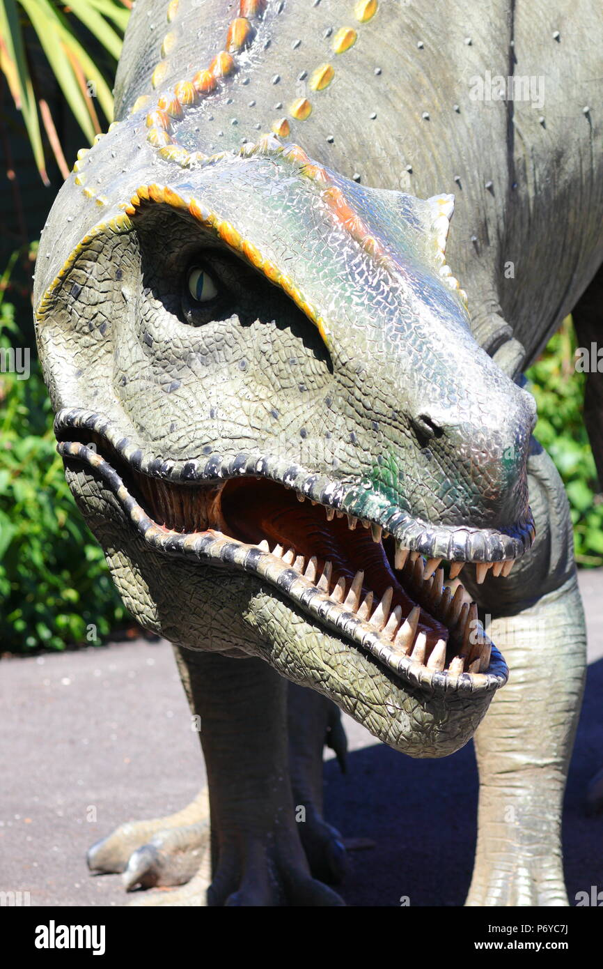 A scary lifelike life size dinosaur exhibit at the entrance to Paradise Park in Hayle, Cornwall - Stock Image
