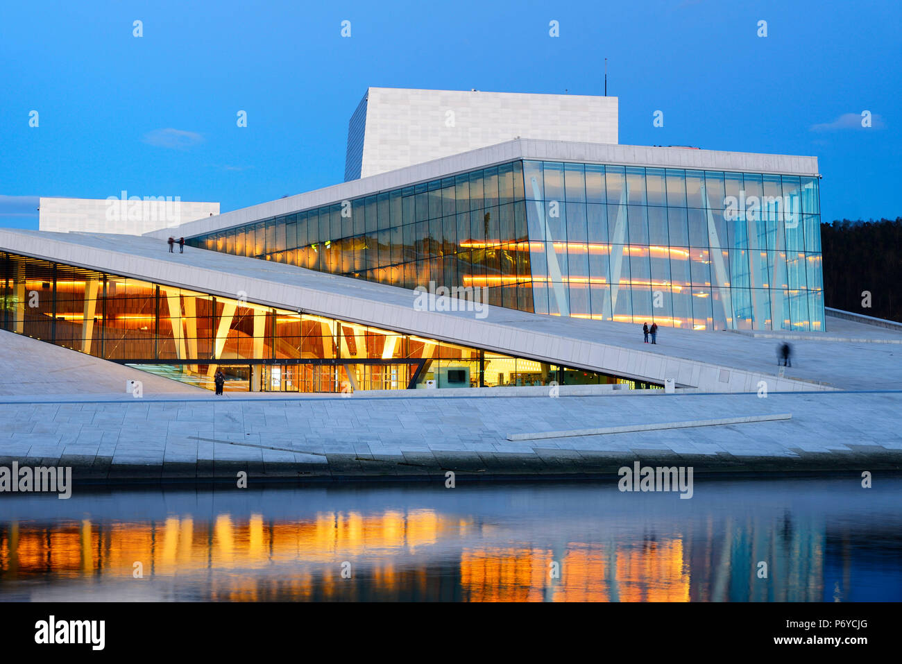 The Opera House, Norwegian National Opera and Ballet, by Snohetta architects in Bjorvika district, in the evening. Oslo, Norway - Stock Image