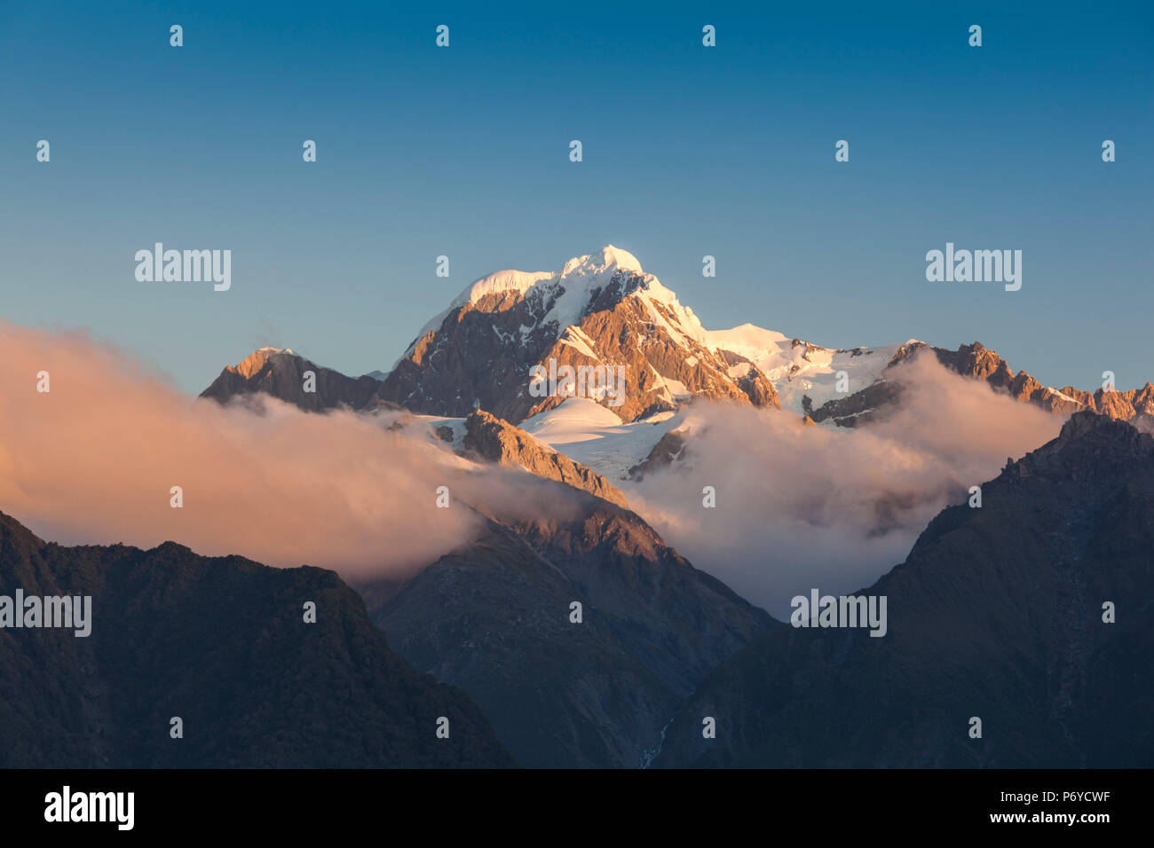 New Zealand, South Island, West Coast, Fox Glacier Village, Lake Matheson, reflection of Mt. Tasman and Mt. Cook, dusk - Stock Image