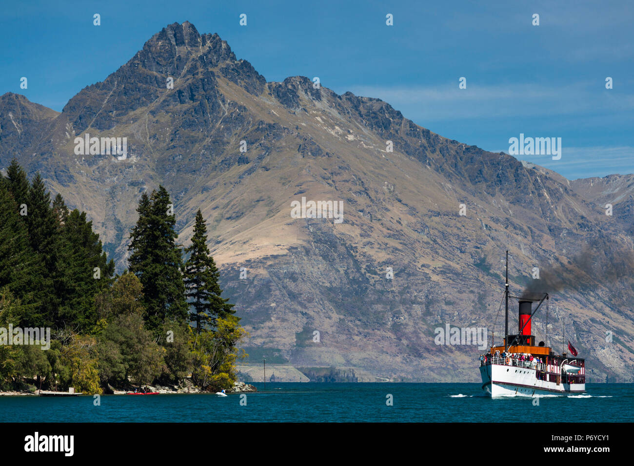 New Zealand, South Island, Otago, Queenstown, The Remarkables Mountains with the steamer TSS Earnslaw - Stock Image