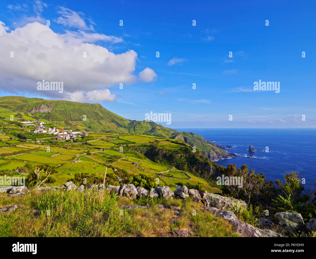 Portugal, Azores, Flores, Landscape with Mosteiro Village and Rocha dos Bordoes. - Stock Image
