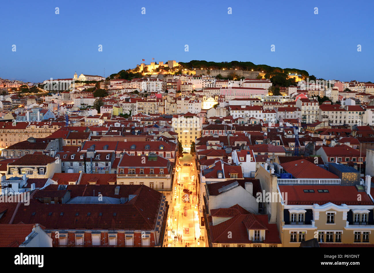 The historic centre (Baixa) and Sao Jorge castle at twilight. Lisbon, Portugal - Stock Image