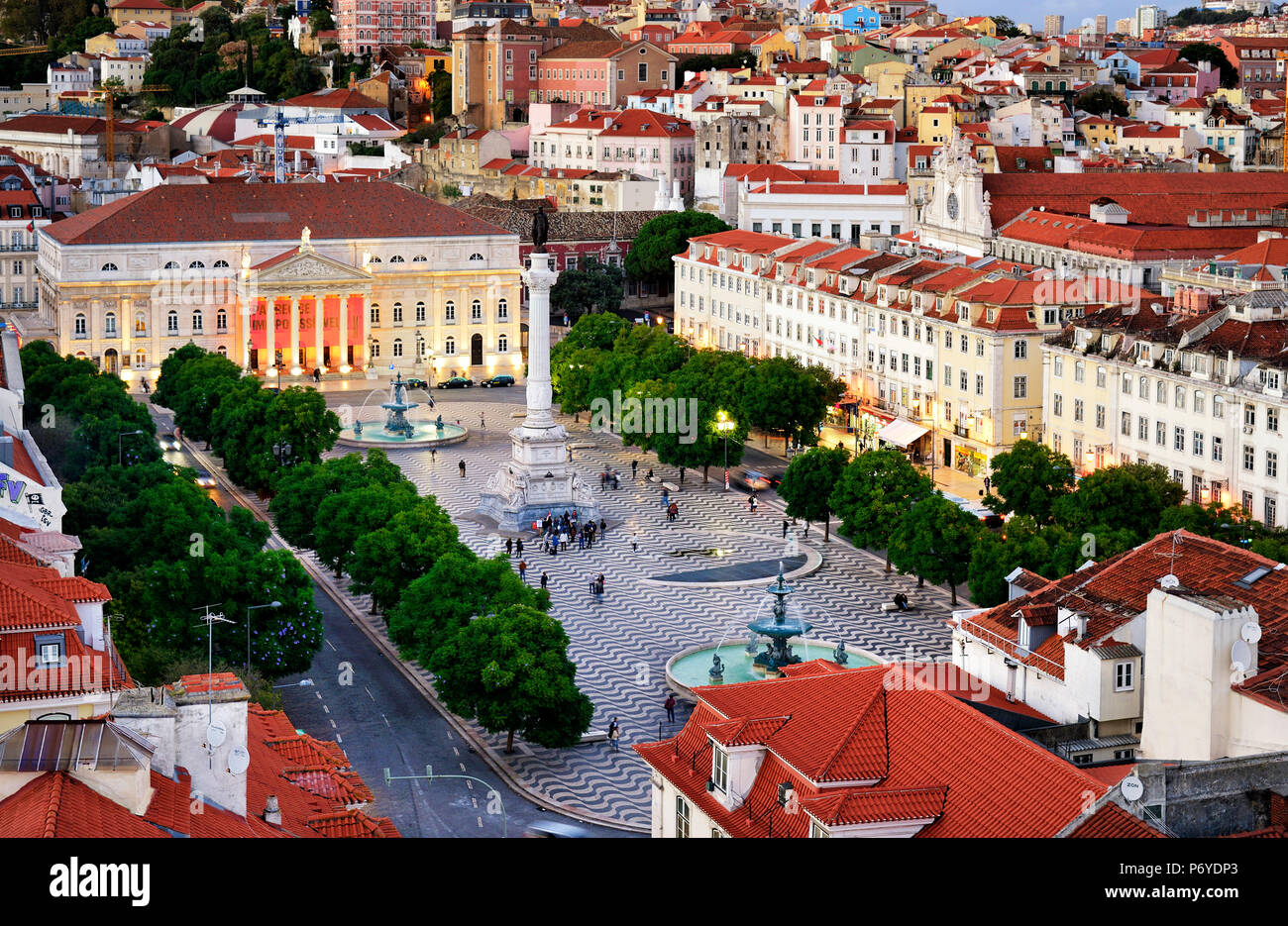 Rossio square or Praca Dom Pedro IV, the heart of the historic centre at twilight. Lisbon, Portugal - Stock Image
