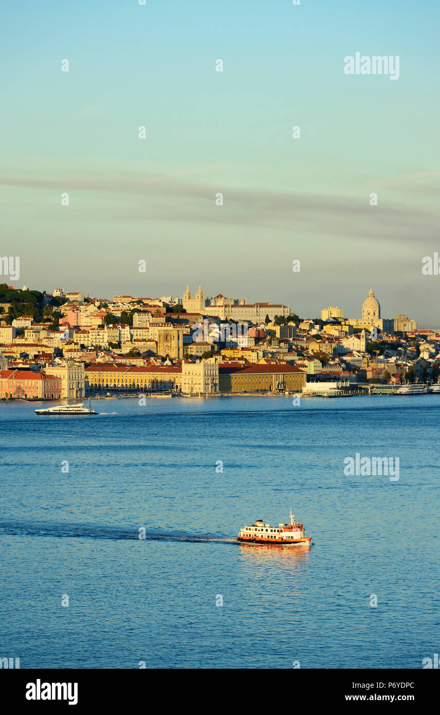 The Tagus river (Tejo river) and the historic centre of Lisbon in the evening. Portugal - Stock Image
