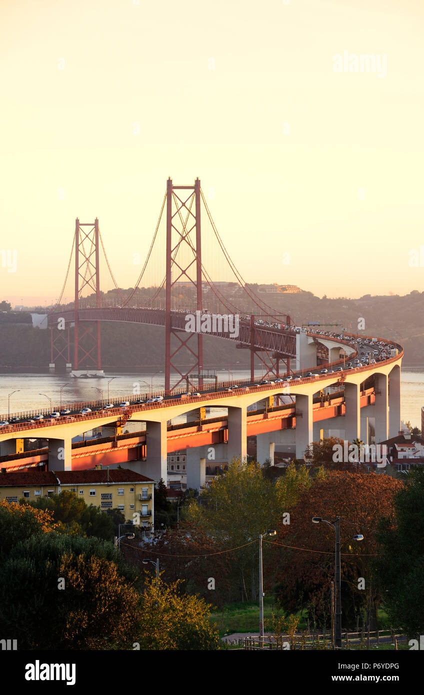 25 de April bridge (similar to the Golden Gate bridge) across the Tagus river, in the evening. Lisbon, Portugal - Stock Image