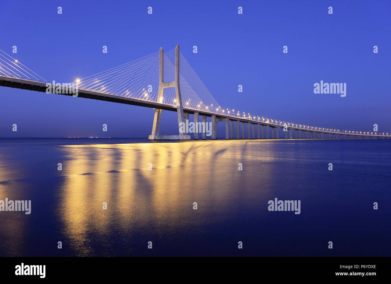 Vasco da Gama Bridge over the Tagus river (Tejo river), the longest bridge in Europe. Lisbon, Portugal - Stock Image