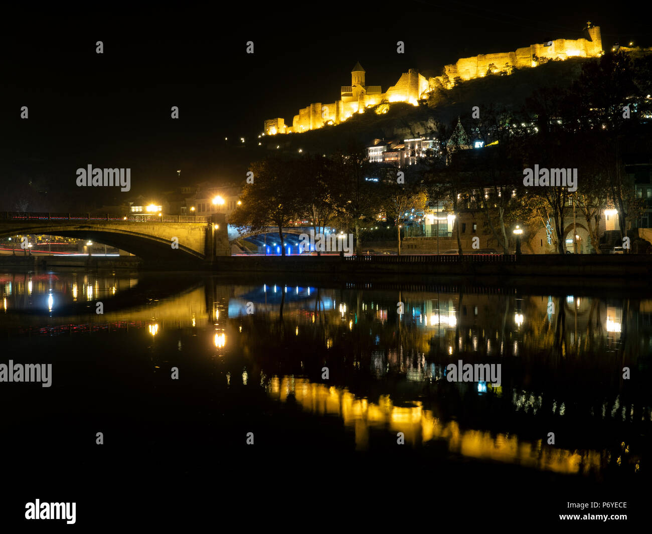 Colorful nightscape of Tbilisi : reflection of illuminated Narikala fortress in Mtkvari river Stock Photo
