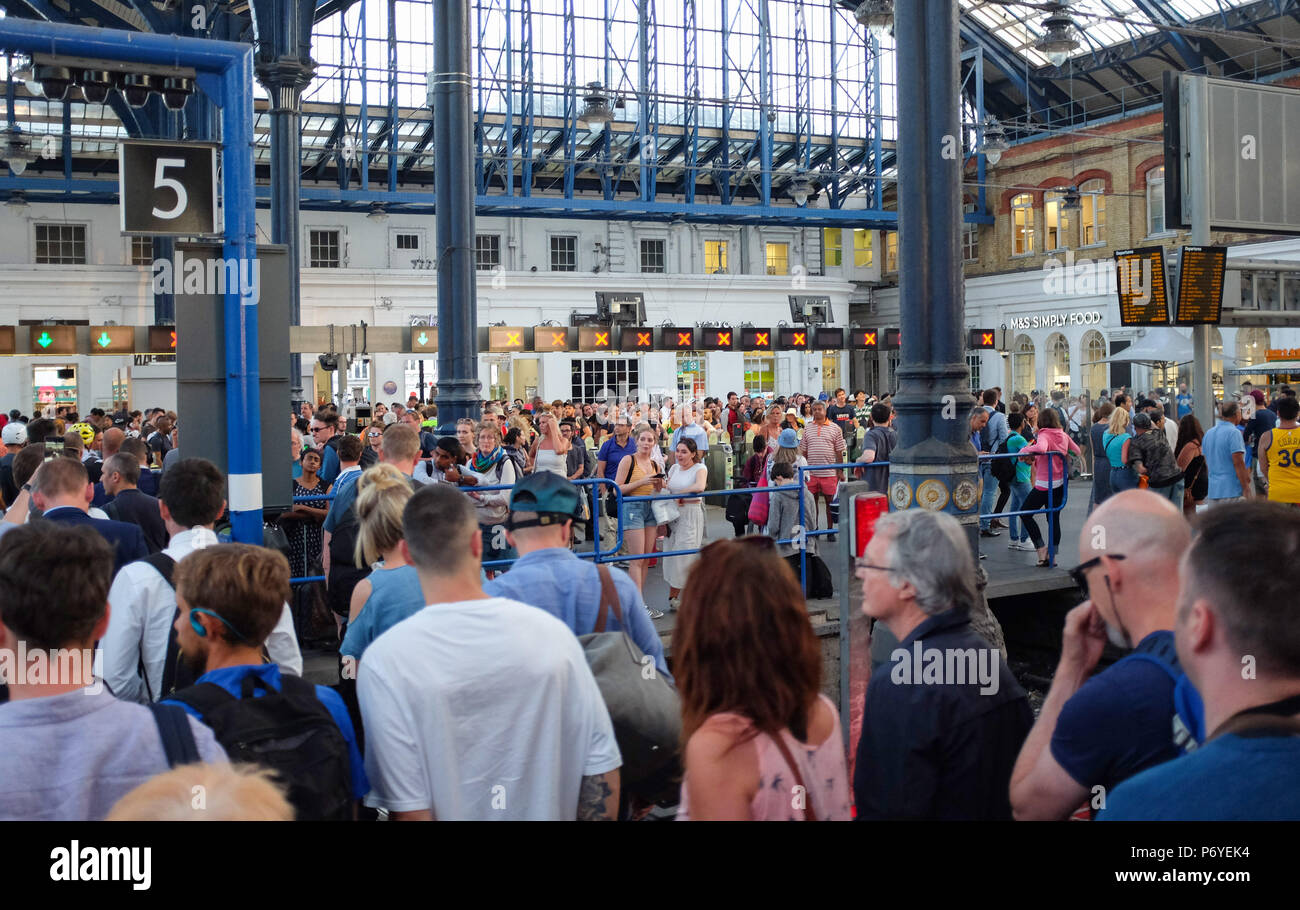 Brighton UK 2nd July 2018 - Passengers arrive back into Brighton Station after long delays on  a Gatwick Express train caused by signal problems from London Victoria - Stock Image