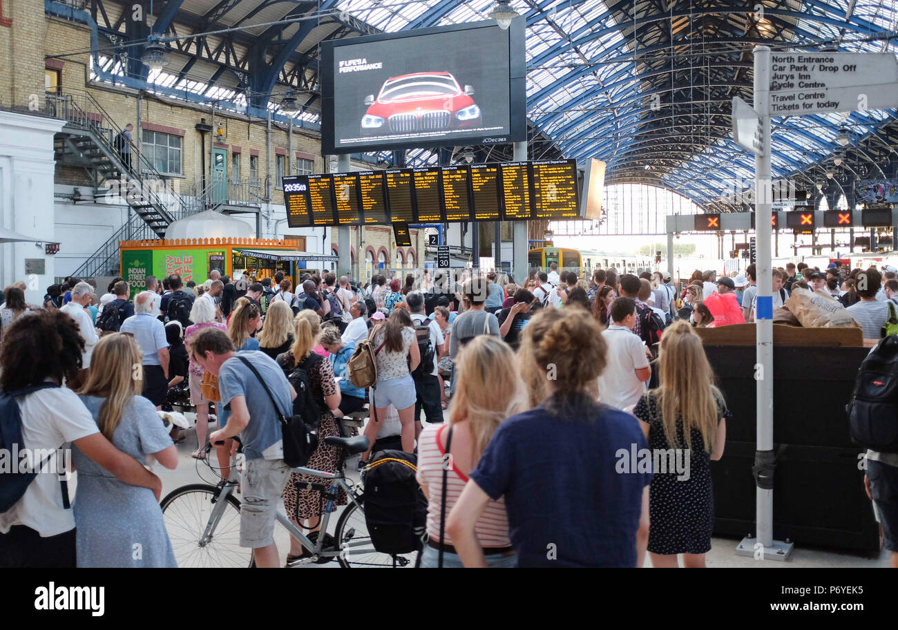 Brighton UK 2nd July 2018 - Passengers waiting at Brighton Station as long delays were caused by signal problems on the Brighton to London line - Stock Image
