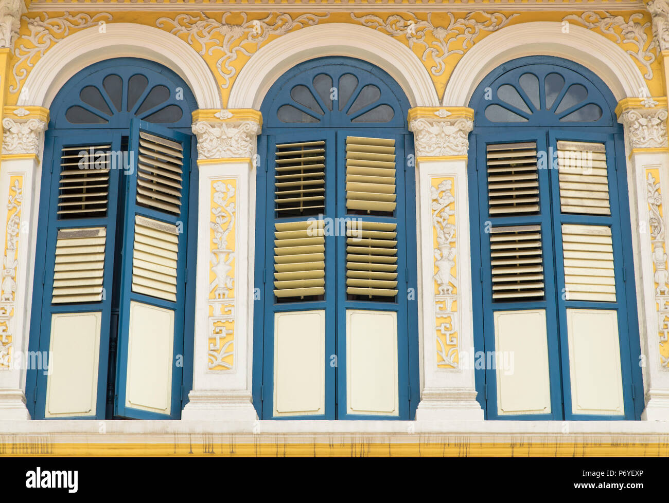 Shutters of traditional shophouse, Singapore - Stock Image