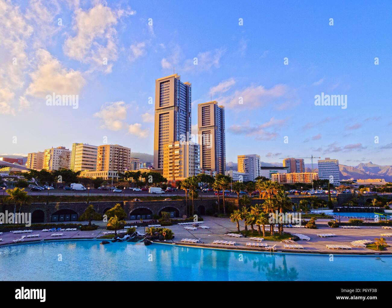 Spain, Canary Islands, Tenerife, Santa Cruz de Tenerife, Skyline of the city with Torres de Santa Cruz and Parque Maritimo Cesar Manrique. Stock Photo