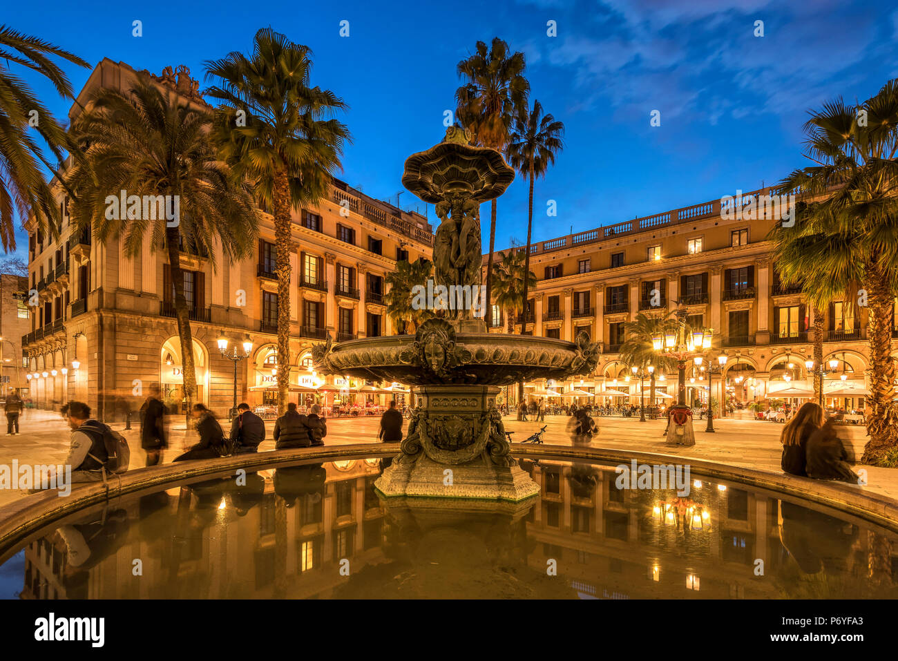 Night view of Placa Reial square (Plaza Real) in the Gothic Quarter, Barcelona, Catalonia, Spain Stock Photo