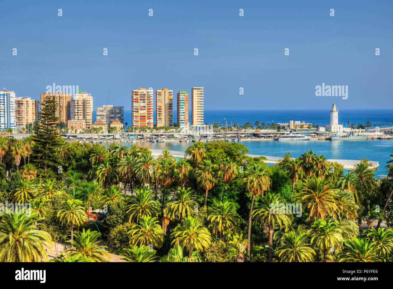 View at harbour with lighthouse, Malaga, Costa del Sol, Andalusia, Spain - Stock Image
