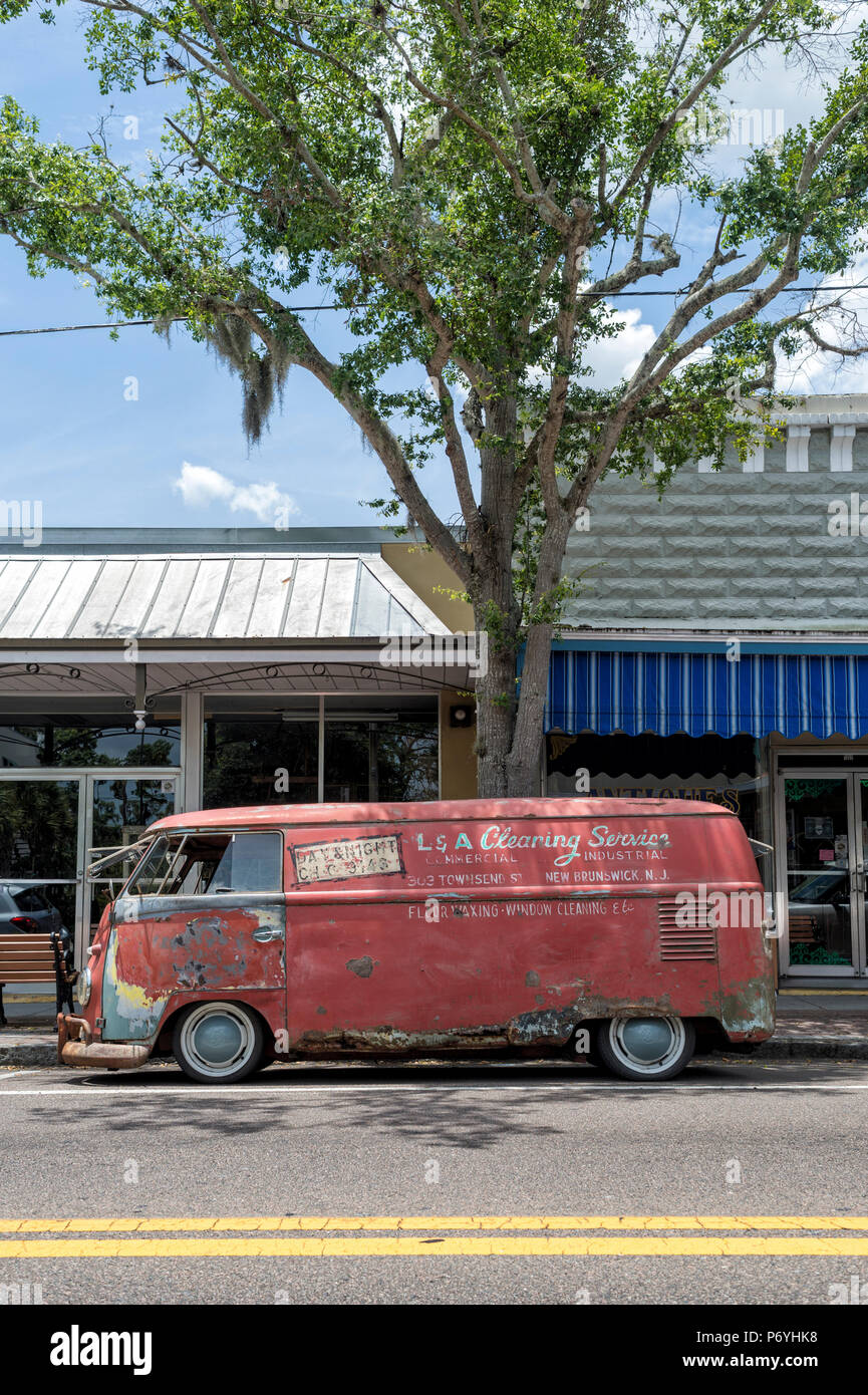 old rusty VW van parked in the street, USA - Stock Image