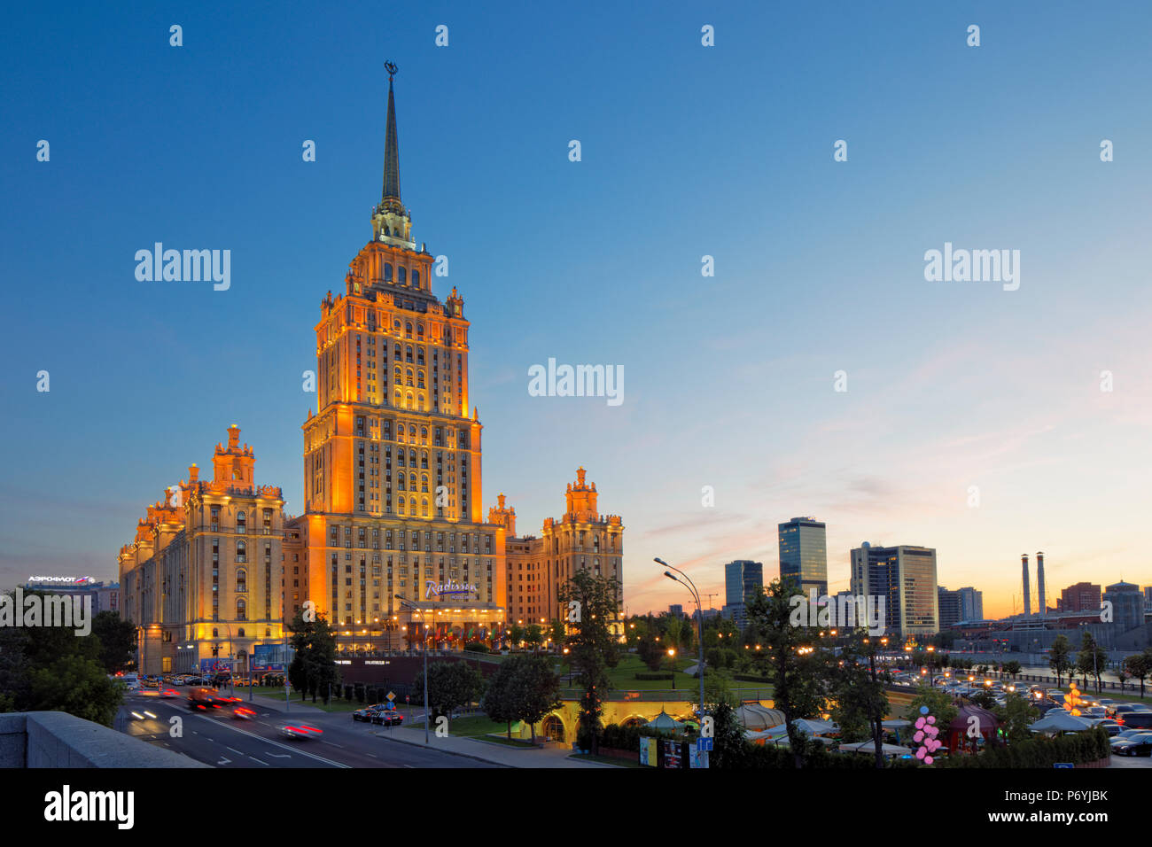 Radisson Royal Hotel Stalinist style high-rise building illuminated at dusk. Moscow, Russia. - Stock Image