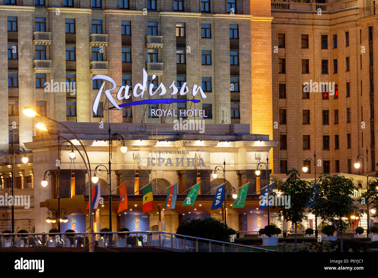 Facade detail of Radisson Royal Hotel Stalinist style high-rise building illuminated at dusk. Moscow, Russia. - Stock Image