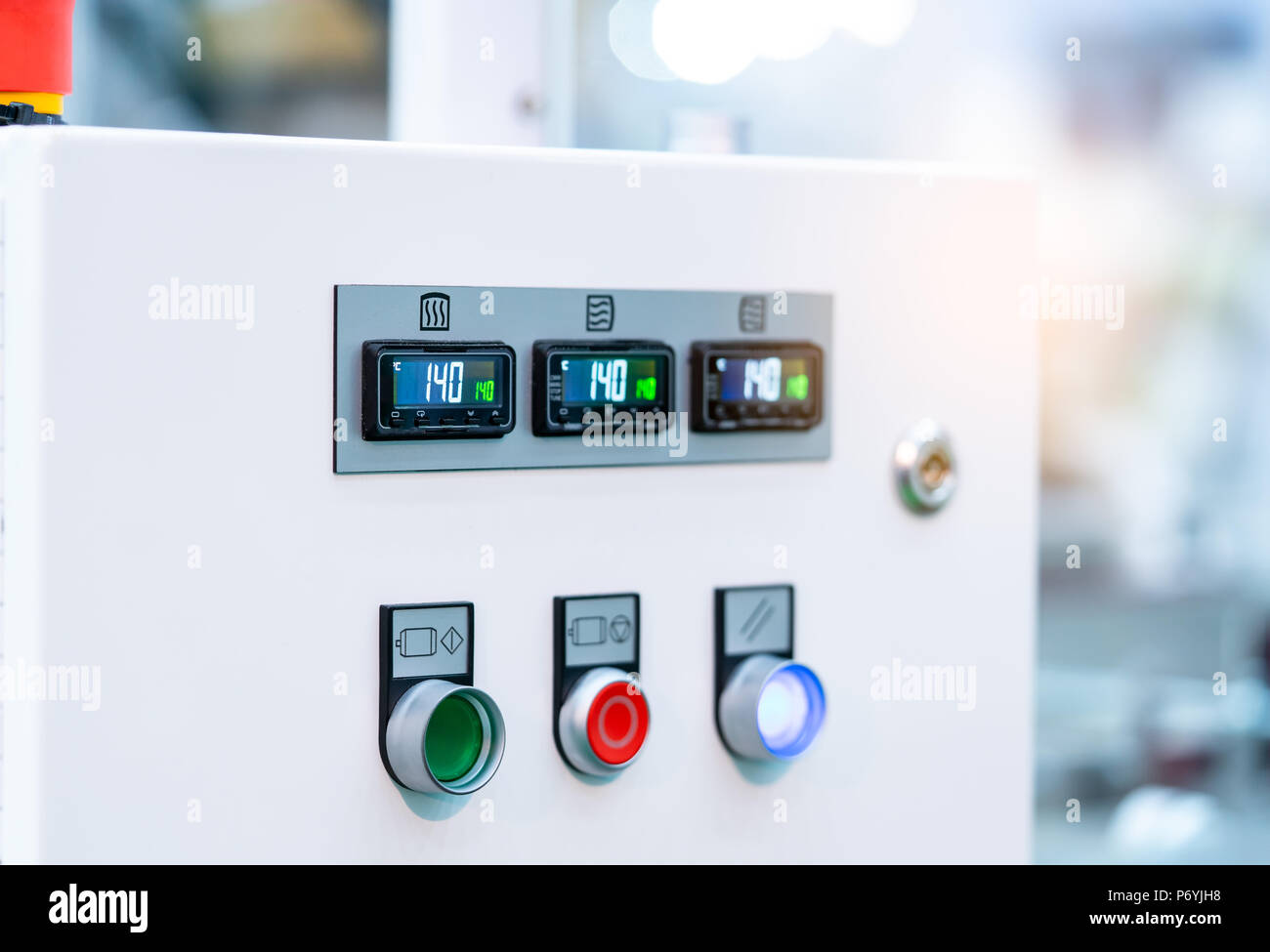 Temperature control panel cabinet contain digital screen display for temperature gauge. green, red, and white button for open, shutdown, and adjust ma - Stock Image