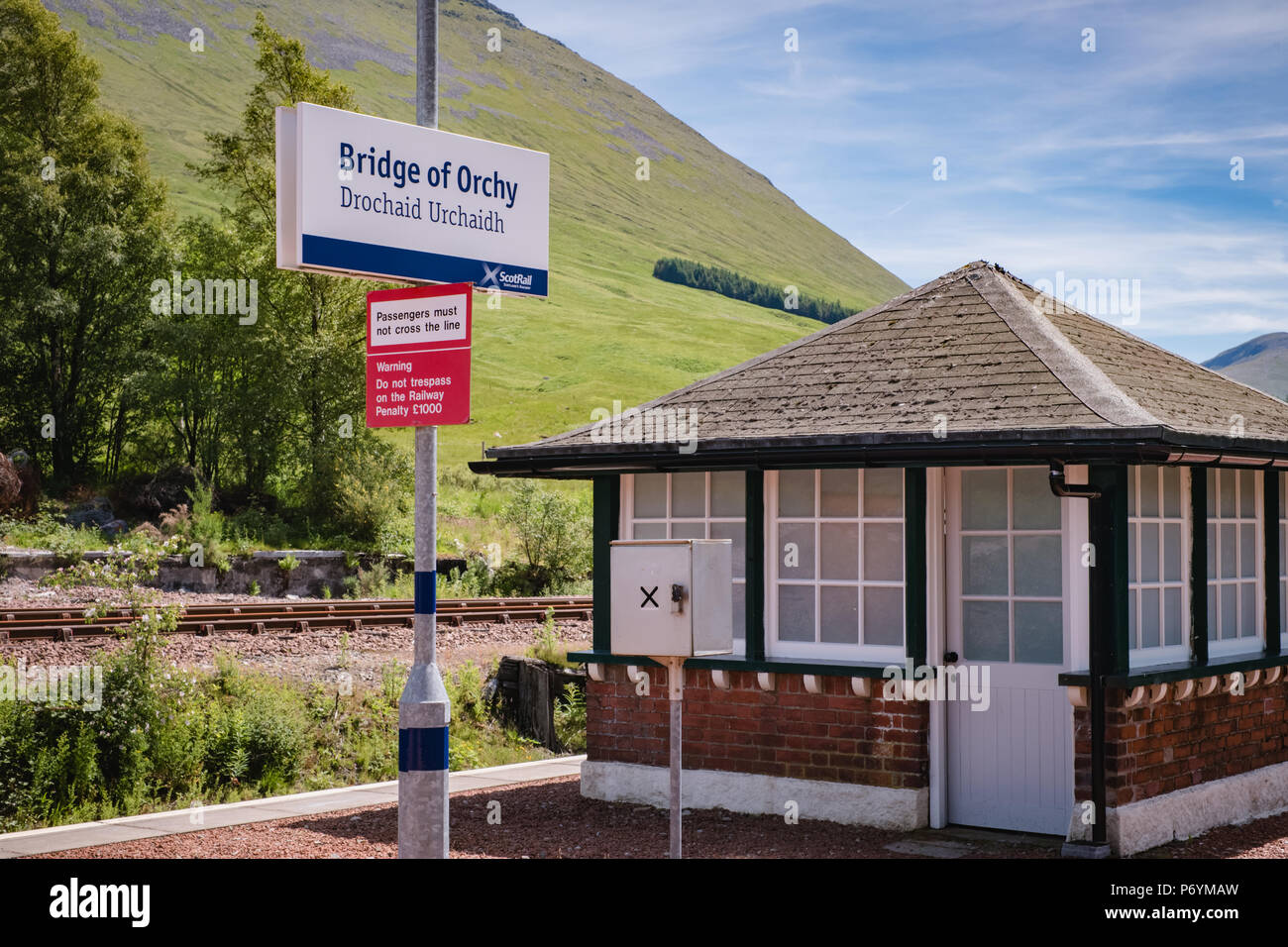 Station sign at the beautiful scenic Bridge of Orchy station on the West Highland train line, on a sunny day in June 2018 Stock Photo
