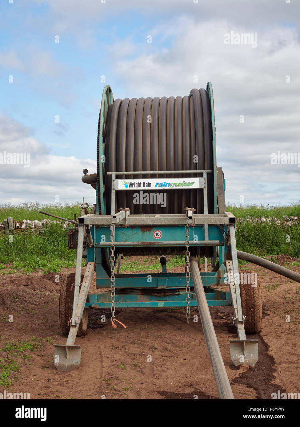 Head on view of the Wright Rain Rainmaker Water Cannon machine with the water pipe coiled onto the drum whilst in use, Arbroath, Angus, Scotland. - Stock Image