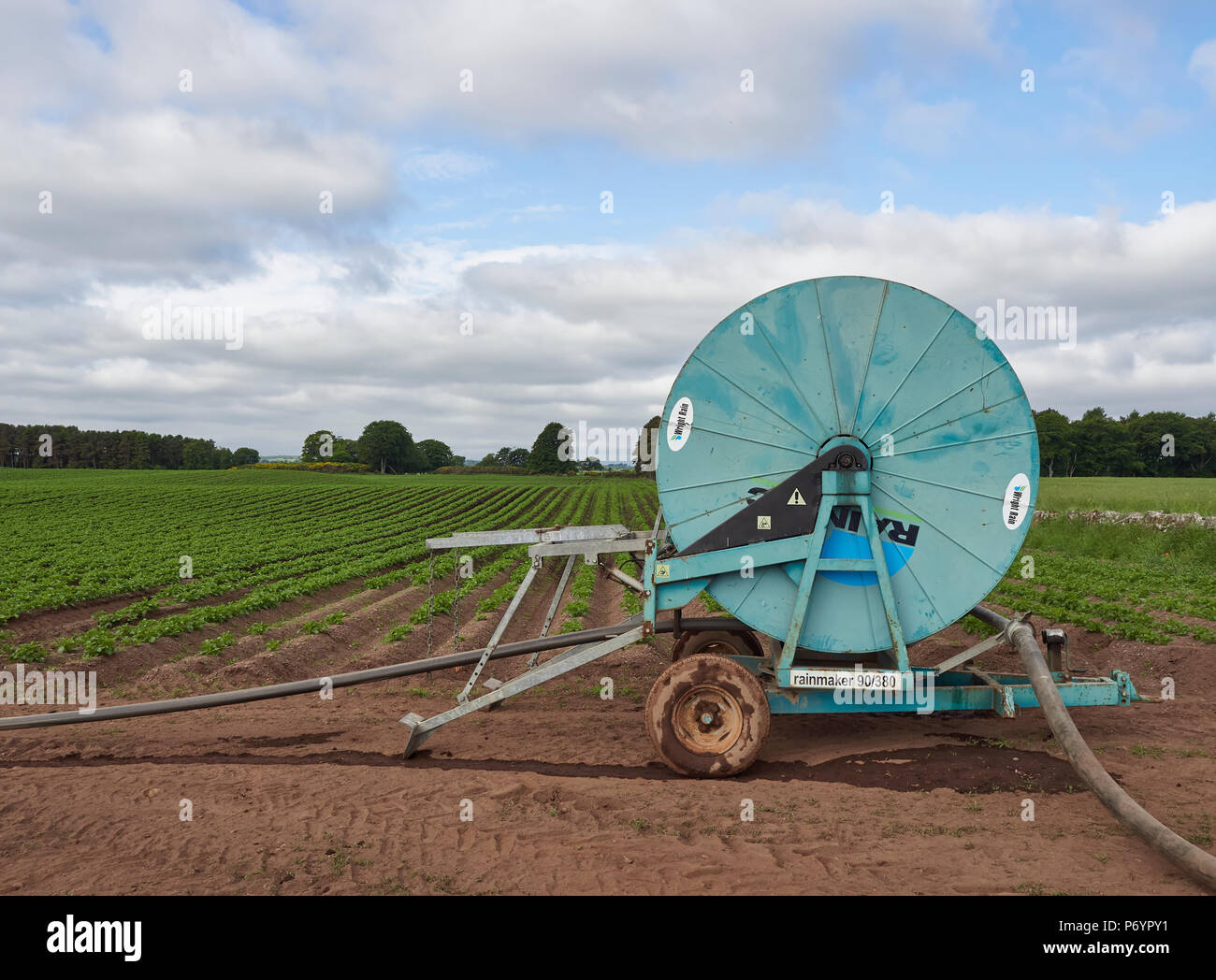 Side on view of a Wright Rainmaker Water Cannon for Agricultural use in the dry conditions being experienced on Angus in Scotland. - Stock Image