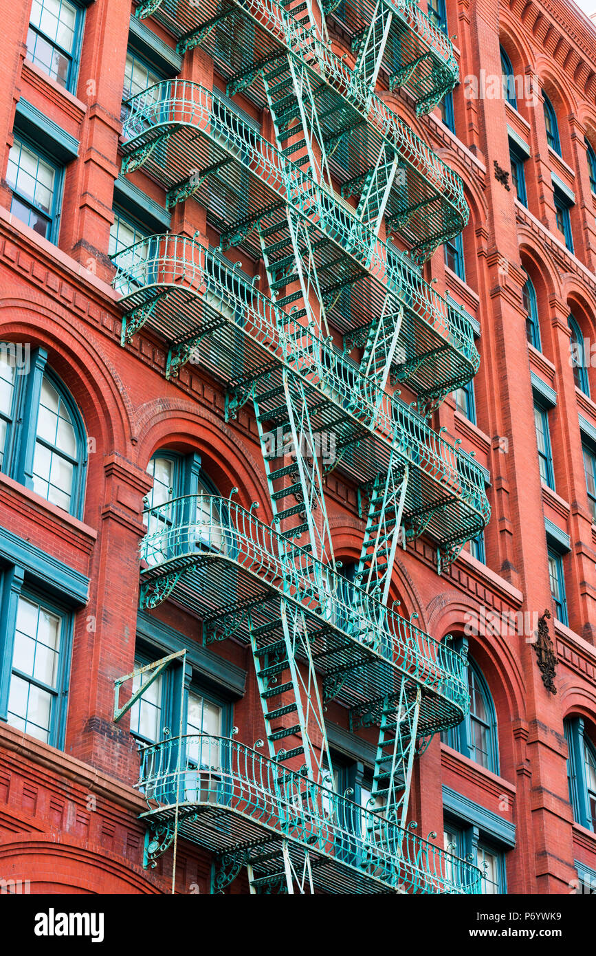 Fire escapes on buildings in Soho, New York, USA - Stock Image