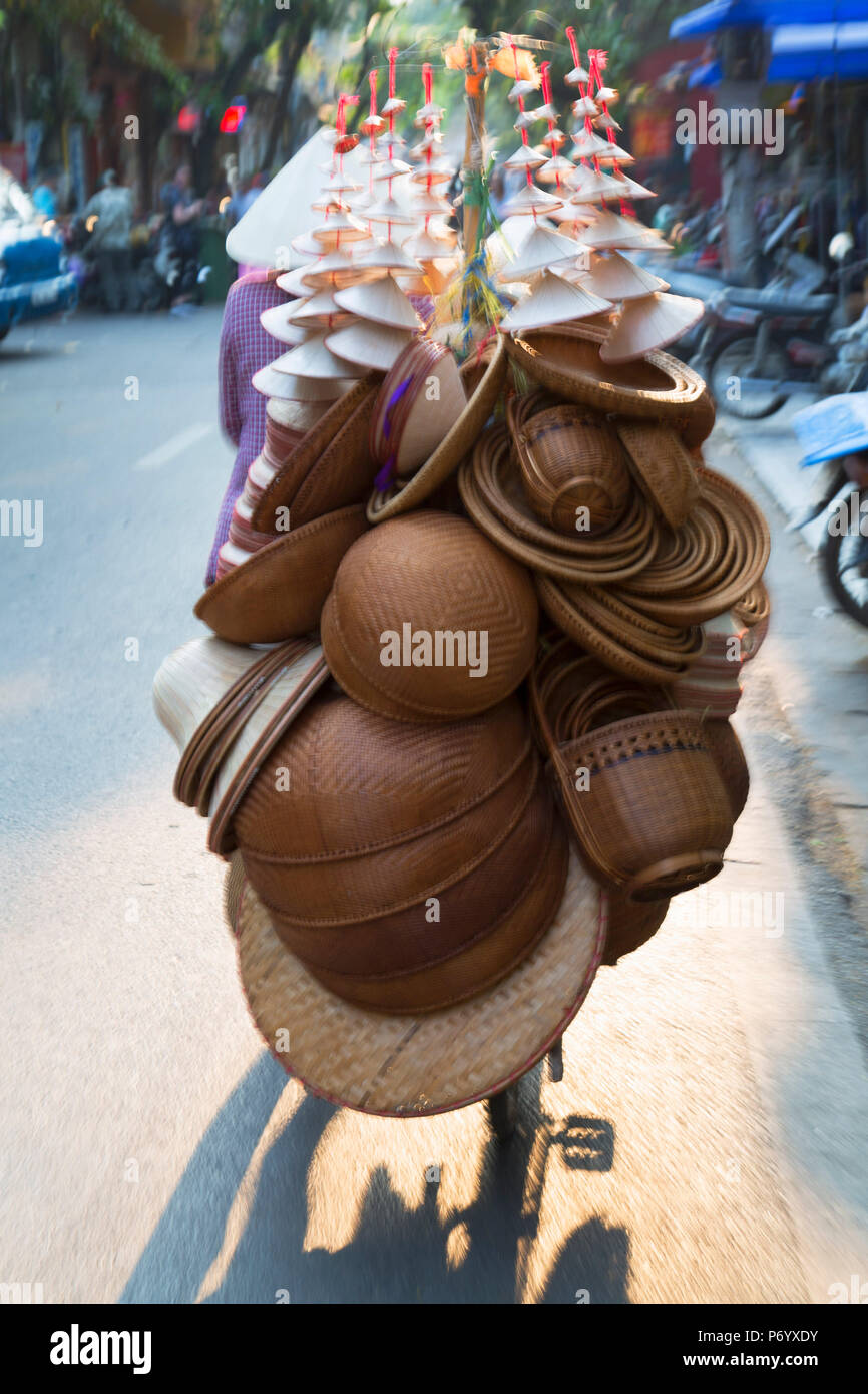 Woman selling goods on bicycle in Old Quarter, Hanoi, Vietnam - Stock Image