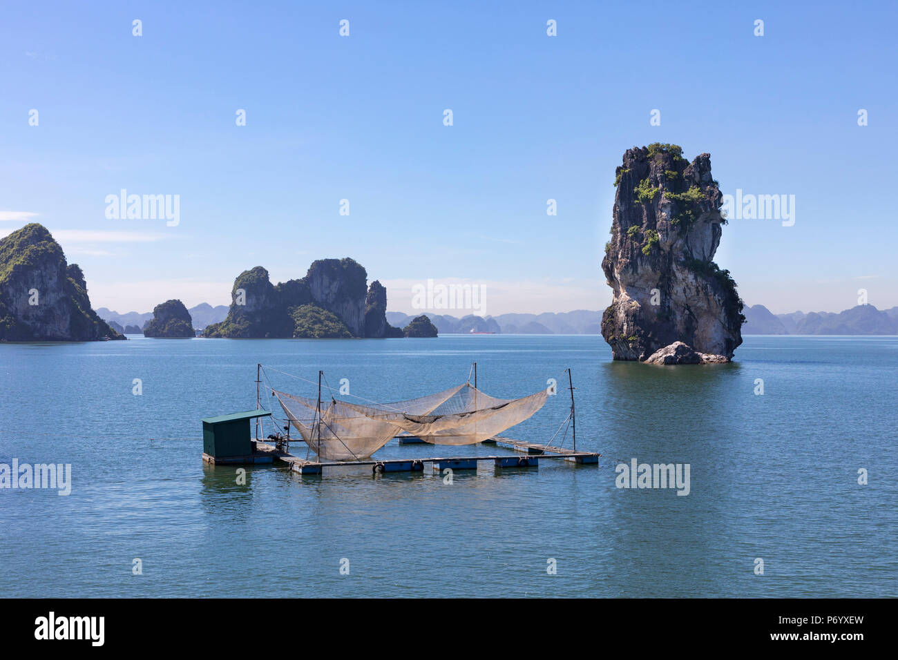 Fishing nets on a raft in front of karst rocks, Halong Bay, Quang Ninh Province, North-East Vietnam, South-East Asia Stock Photo