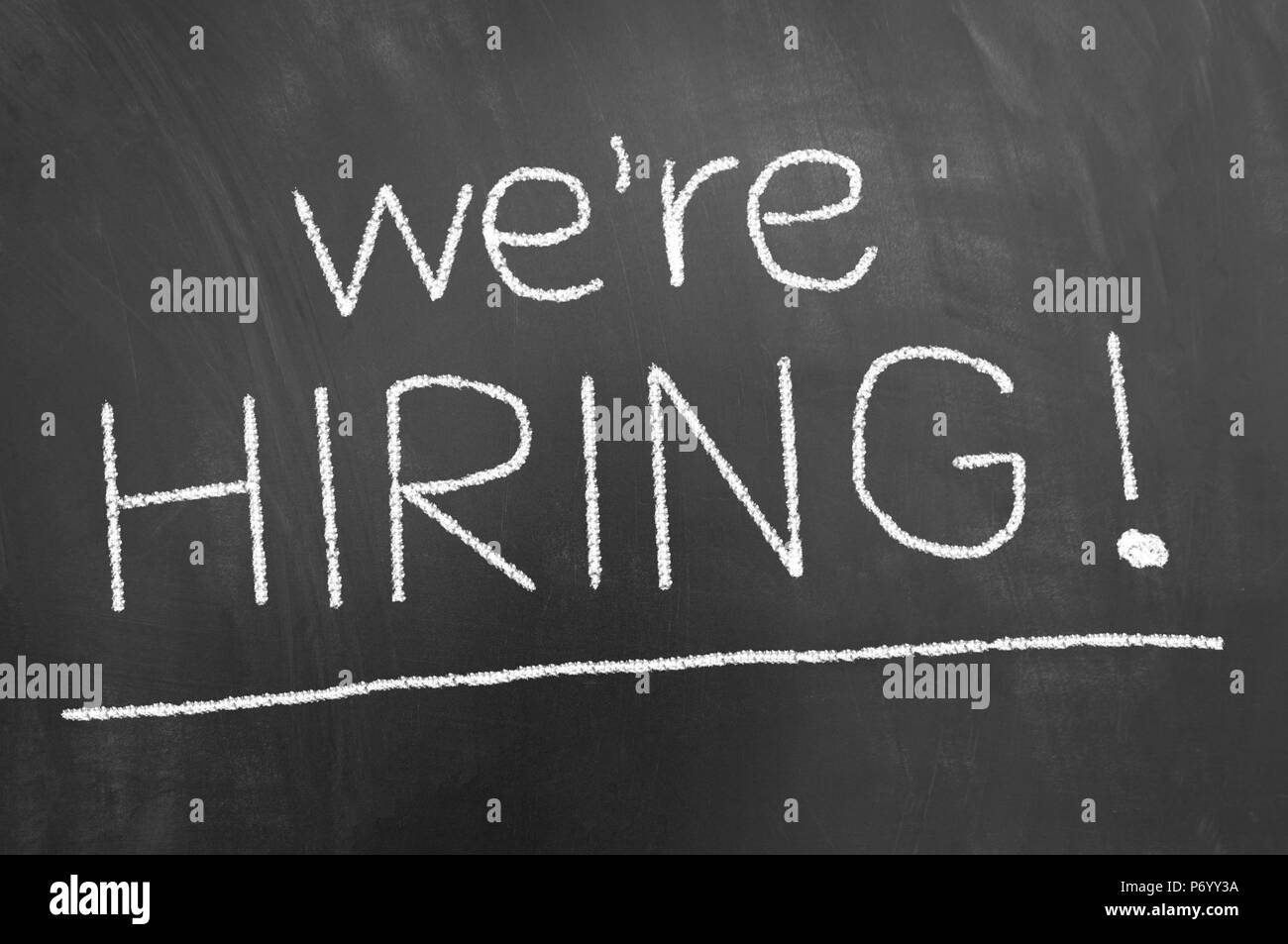 we are hiring announcement chalk text on blackboard or chalkboard as