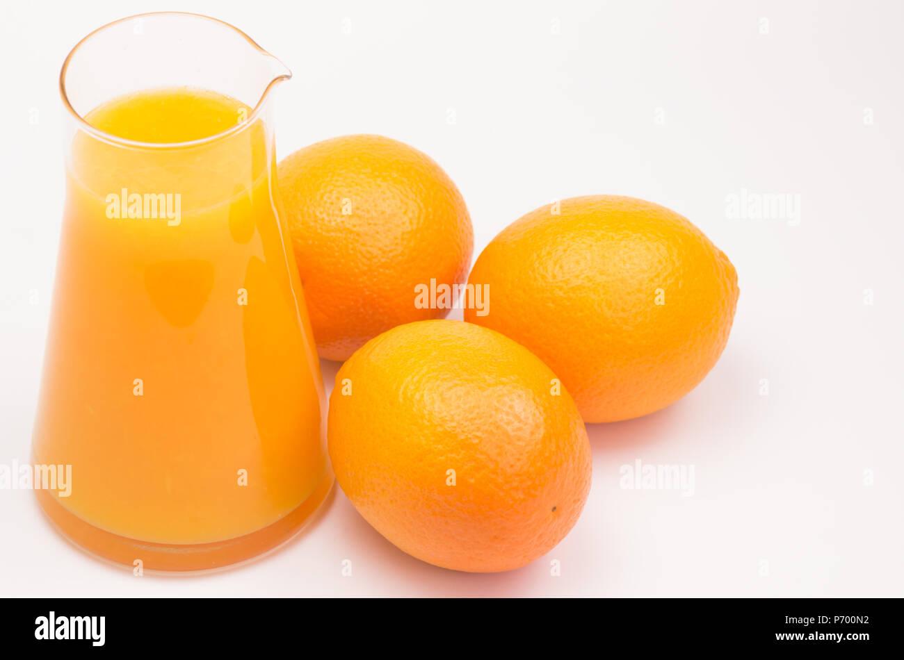 freshly squeezed oranges - white background - Stock Image