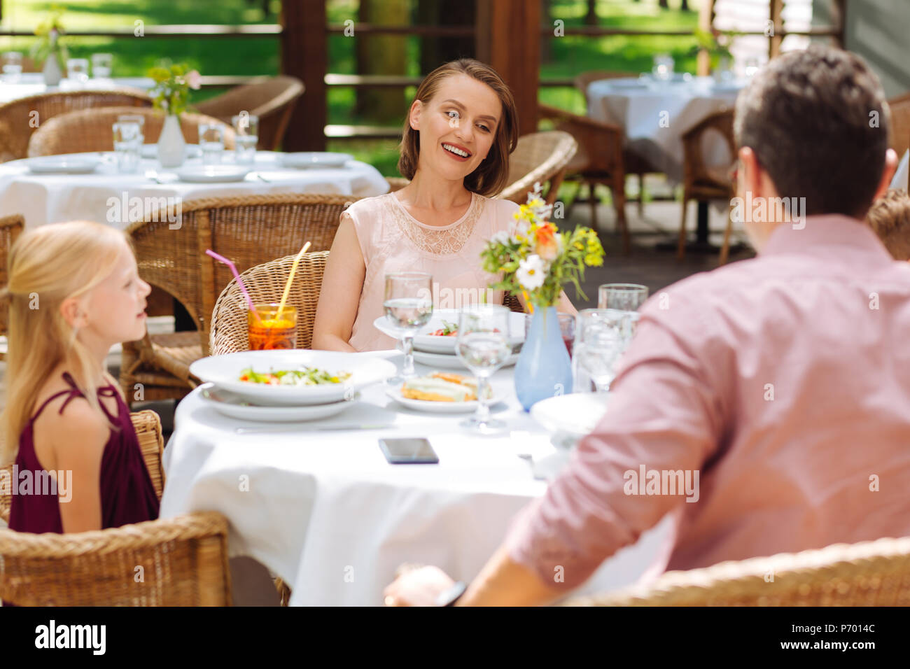 Beaming woman spending her time with family - Stock Image