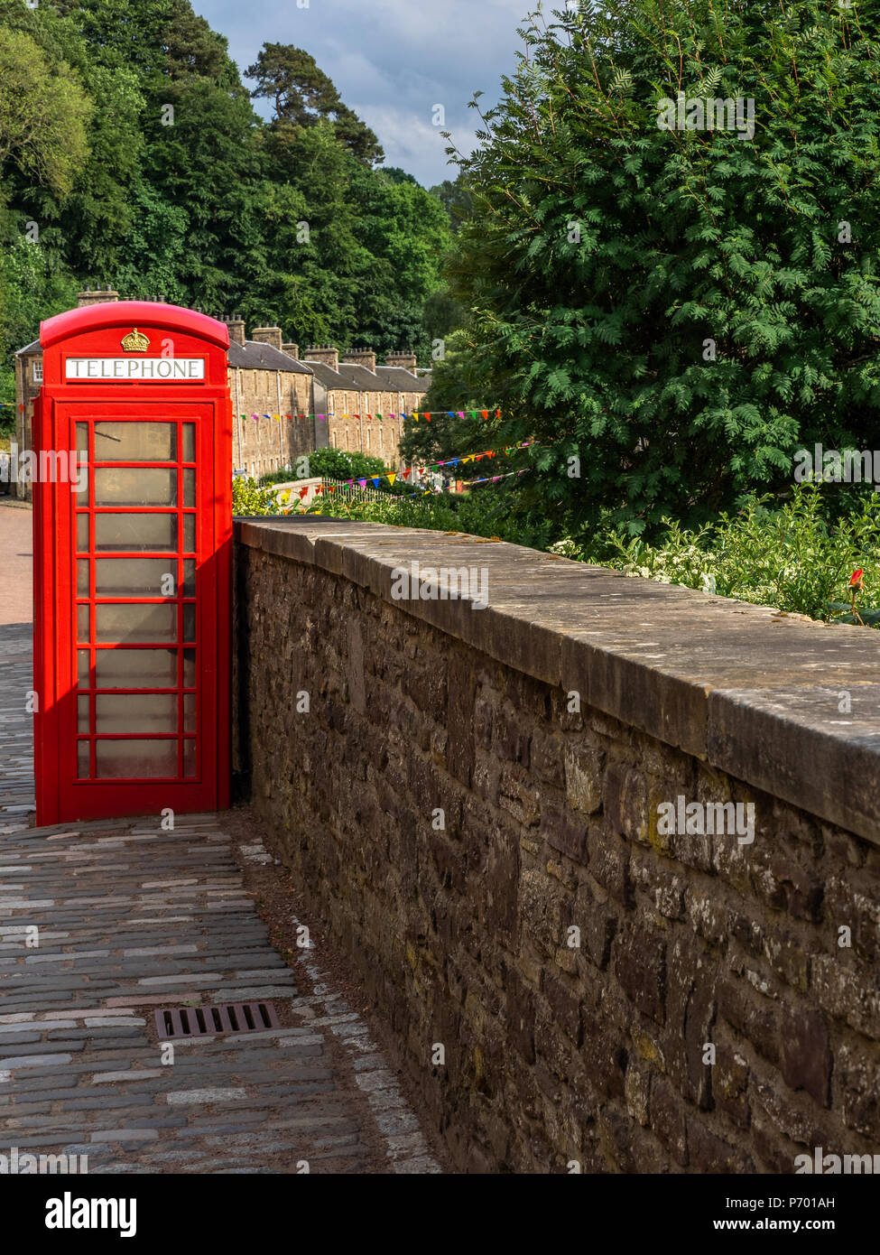 The iconic red British telephone box or kiosk once installed in every town and village with a Post Office is now disappearing from the streets of Brit - Stock Image