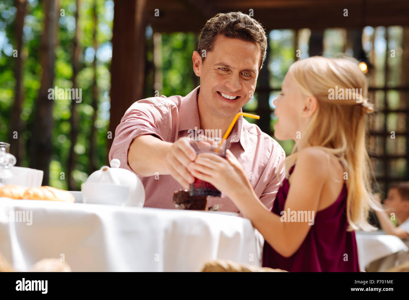 Green-eyed father feeling lovely spending time with daughter