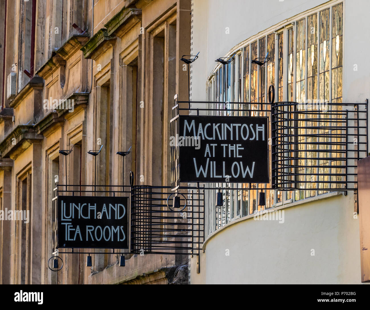 The  setting sun shinning on the Charles Rennie Mackintosh signs for the Willow Tearoom on Sauchiehall Street in Glasgow, Scotland - Stock Image