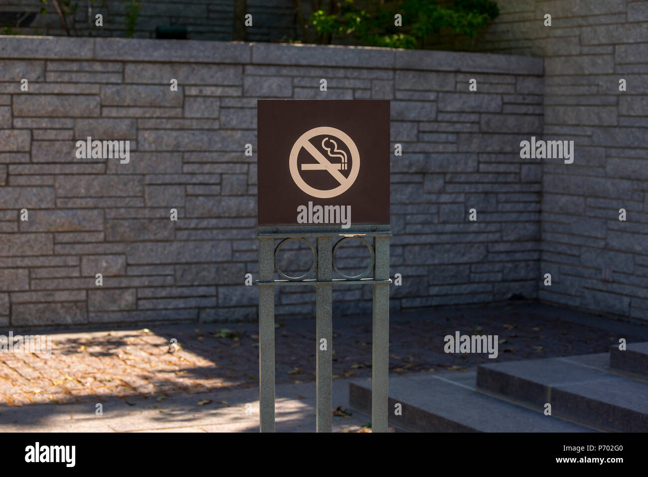No smoking sign near brick wall - Stock Image