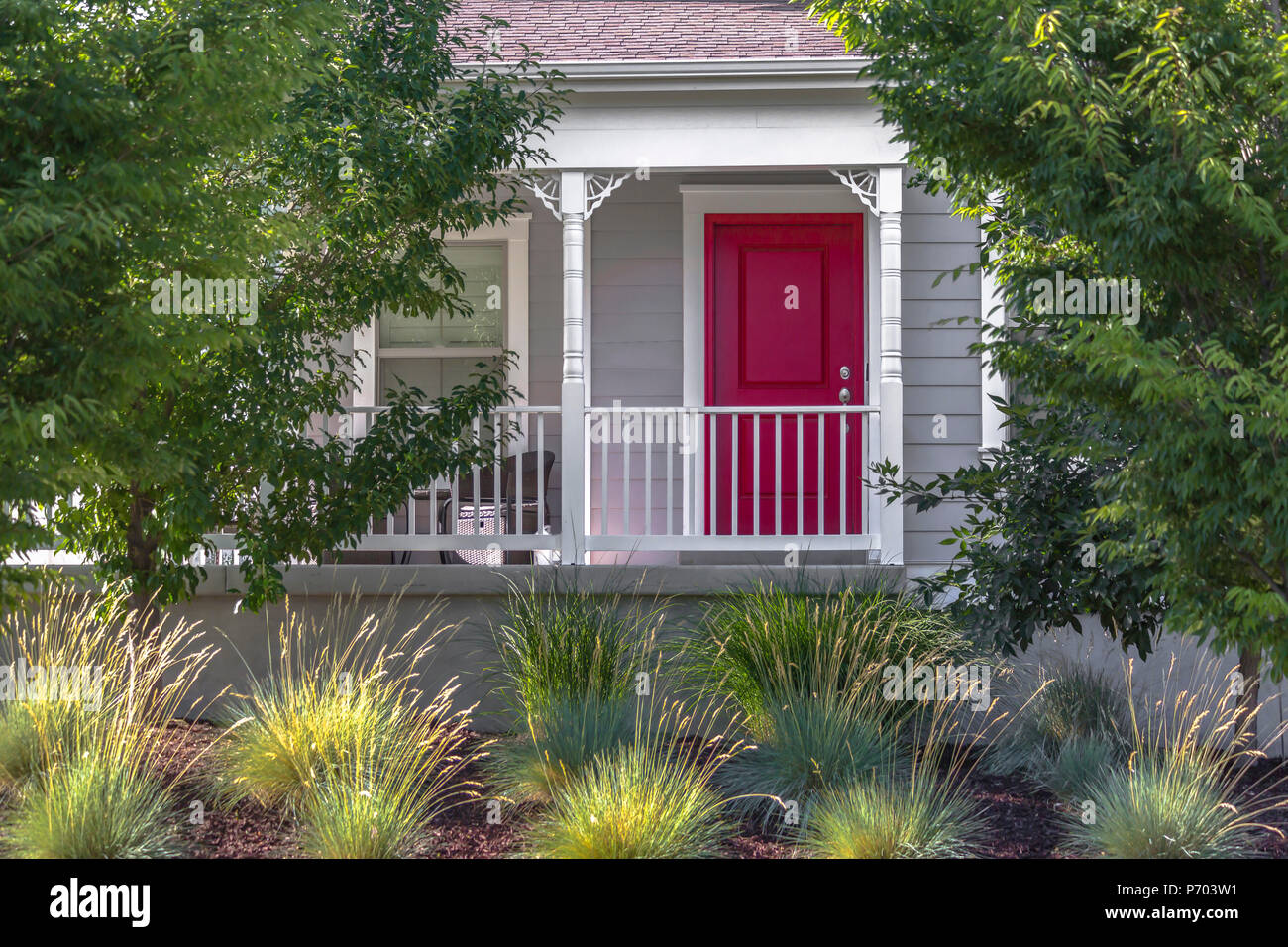 Red Front Door With Front Yard Landscaping