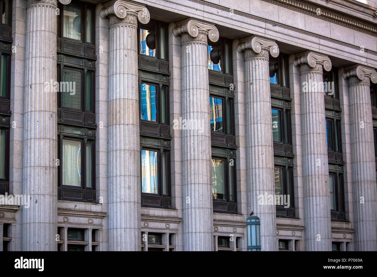 Stone columns seen on stoic building - Stock Image