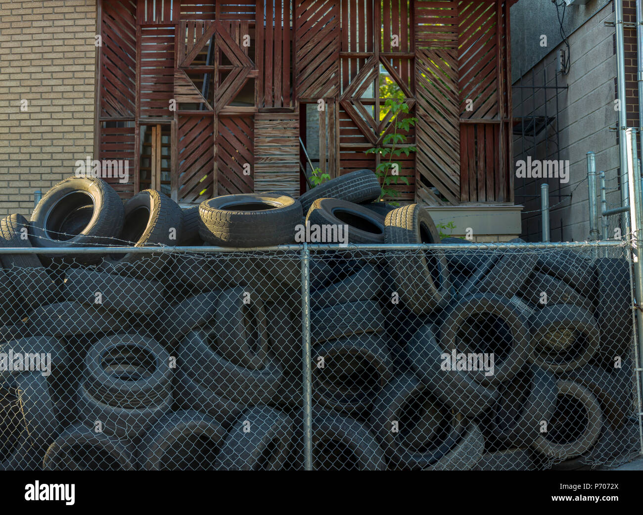 Tires discarded outside shop in downtown - Stock Image