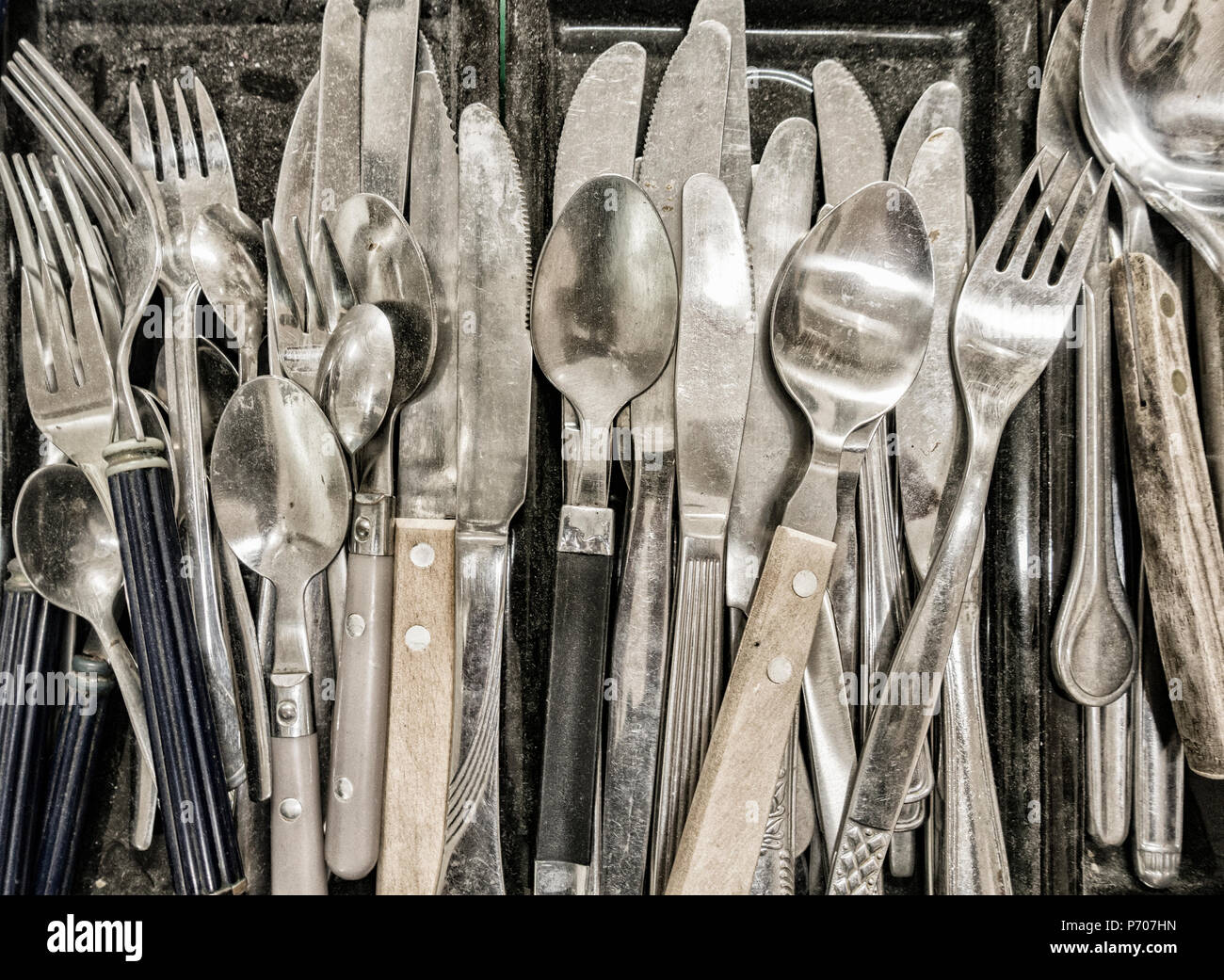 Old cutlery om market stall - Stock Image