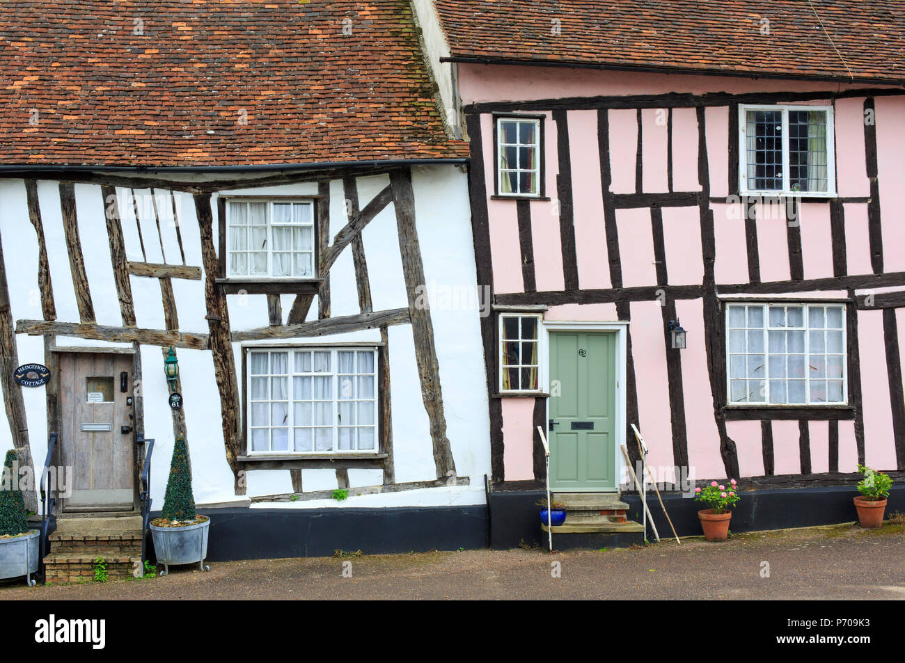 England, Suffolk, Lavenham, Old timber framed cottages in the village. - Stock Image