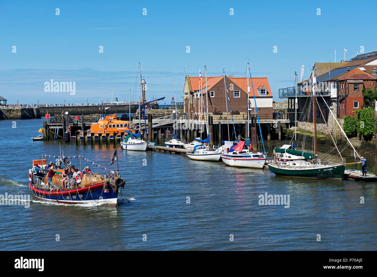 Old lifeboat used for boat trips, Whitby, North Yorkshire, England UK - Stock Image