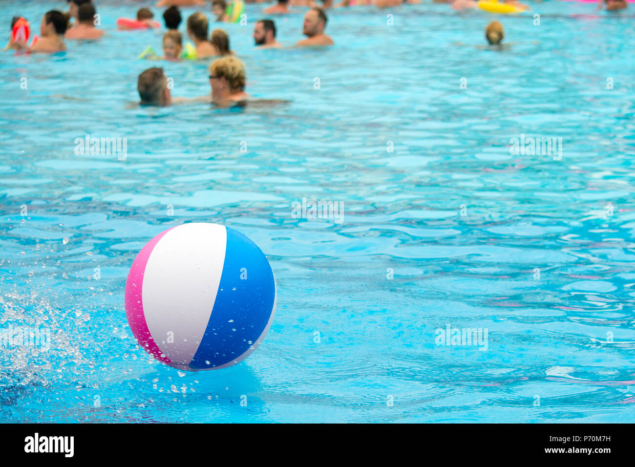 swimming pool beach ball background. Beach Ball Floating In A Blue Swimming Pool. Summer Background. - Stock  Image Pool Beach Background