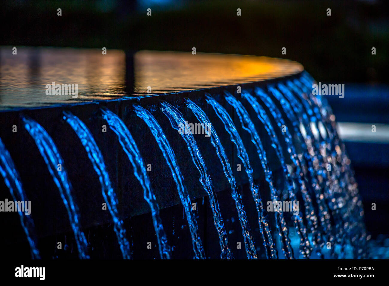 Water fountain detail shot at twilight - Stock Image