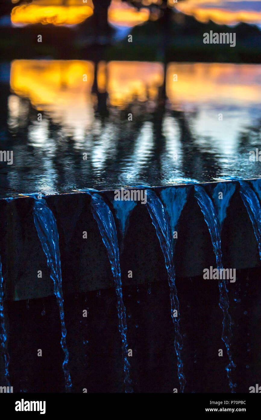 Water fountain sunset detail shot - Stock Image