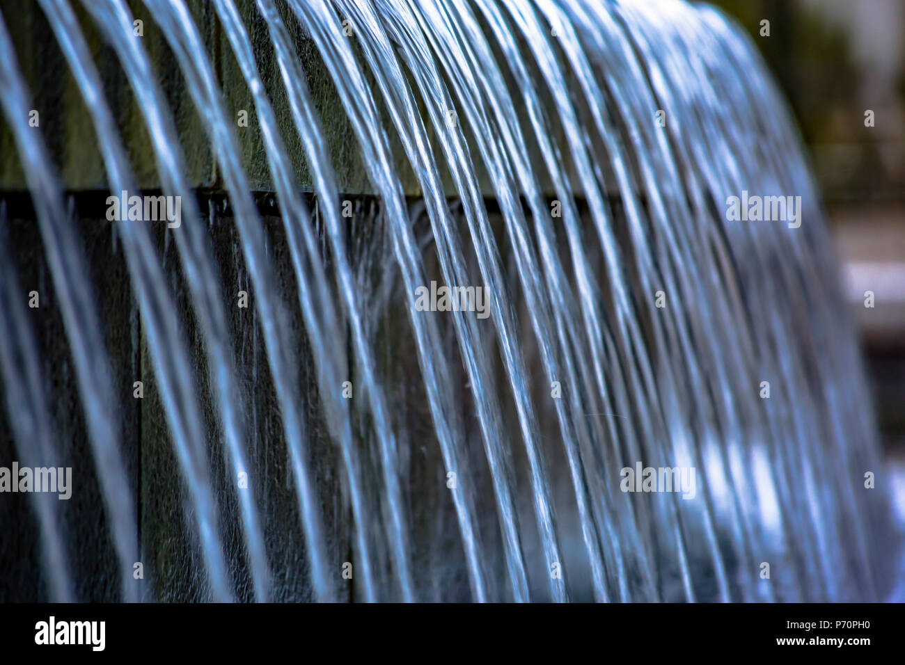 Water fountain with multiple falling streams - Stock Image