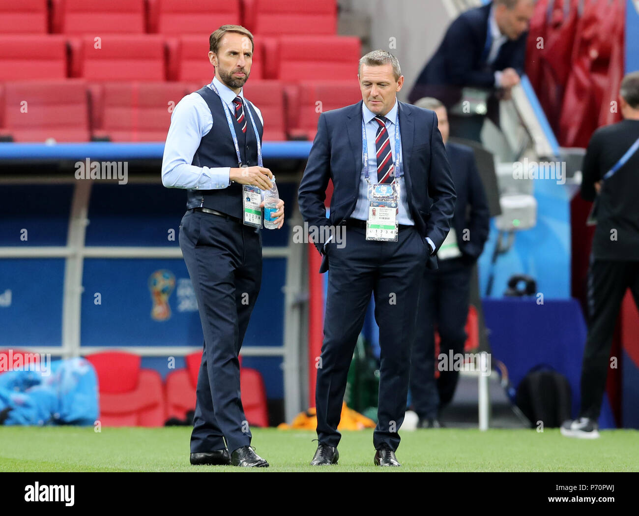 England manager Gareth Southgate (left) and Under 21's manager Tony Mowbray walk the pitch prior to the FIFA World Cup 2018, round of 16 match at the Spartak Stadium, Moscow. - Stock Image