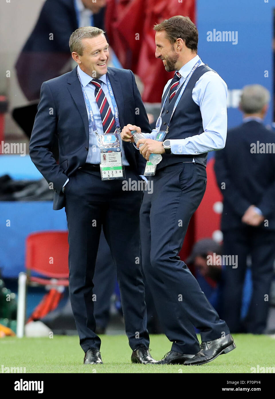 England manager Gareth Southgate (right) and Under 21's manager Tony Mowbray walk the pitch prior to the FIFA World Cup 2018, round of 16 match at the Spartak Stadium, Moscow. - Stock Image