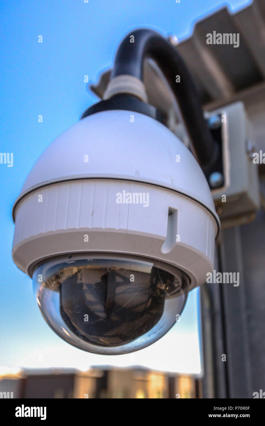 White dome security camera in business area - Stock Image