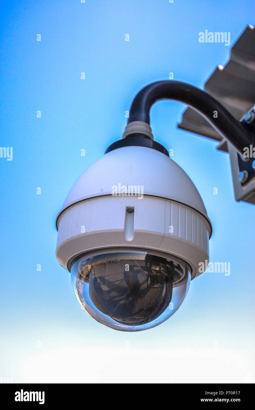 White dome security camera in business districtes - Stock Image