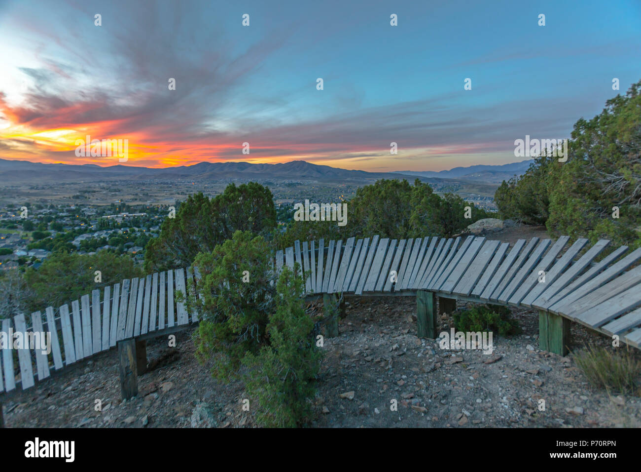Wooden berm at sunset in the hills - Stock Image